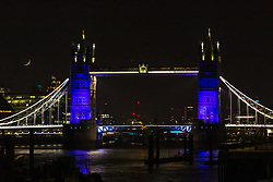 © Licensed to London News Pictures. 26/03/2020. London, UK. Tower bridge is illuminated in blue this evening in recognition and appreciation of National Health Service (NHS) staff working in hospitals across the country during the ongoing COVID-19 coronavirus epidemic. Photo credit: Vickie Flores/LNP