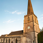 Afternoon light on the Parish Church of St Mary in Painswick, Gloucestershire, in England's Cotswolds region.