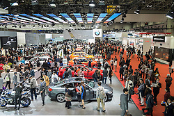 Interior view of exhibition hall at Tokyo Motor Show 2013 with large crowds of visitors