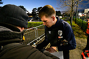 Chris Mepham (33) of AFC Bournemouth signing his autograph for fans as hes arrives at the Vitality Stadium before the Premier League match between Bournemouth and Chelsea at the Vitality Stadium, Bournemouth, England on 30 January 2019.