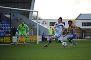 Louis Dodds of Port Vale FC under pressure from Junior Brown of Shrewsbury Town during the Sky Bet League 1 match between Shrewsbury Town and Port Vale at Greenhous Meadow, Shrewsbury, England on 25 March 2016. Photo by Mike Sheridan.