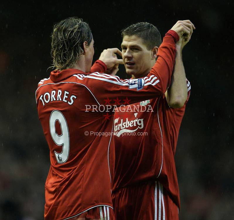 LIVERPOOL, ENGLAND - Sunday, December 2, 2007: Liverpool's Fernando Torres celebrates scoring the second goal against Bolton Wanderers, with his team-mate and captain Steven Gerrard MBE, during the Premiership match at Anfield. (Photo by David Rawcliffe/Propaganda)