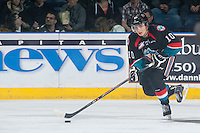 KELOWNA, CANADA - DECEMBER 5: Nick Merkley #10 of Kelowna Rockets skates with the puck against the Prince George Cougars on December 5, 2014 at Prospera Place in Kelowna, British Columbia, Canada.  (Photo by Marissa Baecker/Shoot the Breeze)  *** Local Caption *** Nick Merkley;