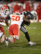 Kansas City Chiefs outside linebacker Justin Houston (50) dives and tackles Oakland Raiders fullback Marcel Reece (45) during the NFL week 12 regular season football game against the Oakland Raiders on Thursday, Nov. 20, 2014 in Oakland, Calif. The Raiders won their first game of the season 24-20. ©Paul Anthony Spinelli