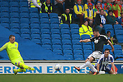 Brentford striker Scott Hogan (9) shoots for goal during the EFL Sky Bet Championship match between Brighton and Hove Albion and Brentford at the American Express Community Stadium, Brighton and Hove, England on 10 September 2016. Photo by Bennett Dean.