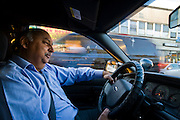 Din Memon, a Chicago taxi driver in his leased taxi on Devon Avenue in Chicago, Illinois. (Din Memon is featured in the book What I Eat: Around the World in 80 Diets.)  MODEL RELEASED.