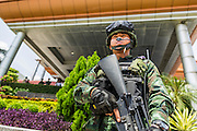 "20 MAY 2104 - BANGKOK, THAILAND: A Thai special operations soldier guards the entrance to the Army Club in Bangkok after the declaration of martial law. Thai army generals called members of Thai society to the Army Club to give them instructions on how to proceed during martial law. The Thai Army declared martial law throughout Thailand in response to growing political tensions between anti-government protests led by Suthep Thaugsuban and pro-government protests led by the ""Red Shirts"" who support ousted Prime Minister Yingluck Shinawatra. Despite the declaration of martial law, daily life went on in Bangkok in a normal fashion. There were small isolated protests against martial law, which some Thais called a coup, but there was no violence.   PHOTO BY JACK KURTZ"