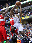 March 29, 2012; Indianapolis, IN, USA; Indiana Pacers shooting guard Dahntay Jones (1) shoots the ball against the Washington Wizards at Bankers Life Fieldhouse. Indiana defeated Washington 93-89. Mandatory credit: Michael Hickey-US PRESSWIRE