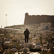 Tunisia, Mahdia : A man prays  in the marine cemetery of Mahdia.Copyright Christian Minelli
