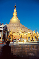 BURMA RANGOON MAR95 - A Burmese man sits in meditation in front of the Shwedagon Pagoda, Rangoon's symbom. The Shwedagon Pagoda is plated with real gold and has a large rubin stone cemented on its top... jre/Photo by Jiri Rezac. . © Jiri Rezac 1995. . Contact: +44 (0) 7050 110 417. Mobile: +44 (0) 7801 337 683. Office: +44 (0) 20 8968 9635. . Email: jiri@jirirezac.com. Web: www.jirirezac.com