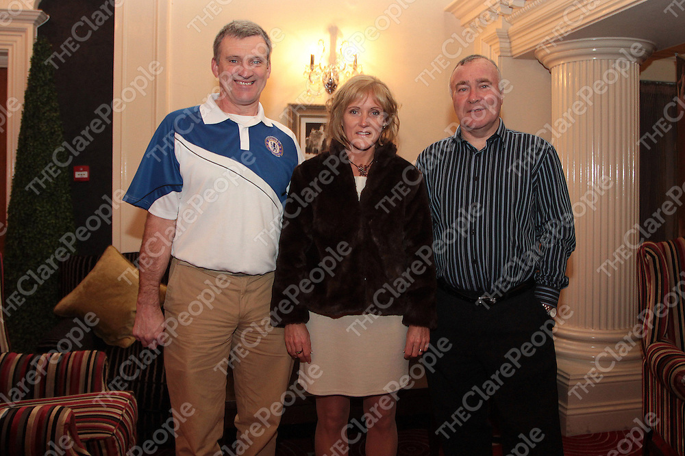 "Ennis Chelsea supporters Neil & Helen O'Hanlon with Ron ""Chopper"" Harris at the Ennis Chelsea Supporters Club Annual Social. - Photograph by Flann Howard"