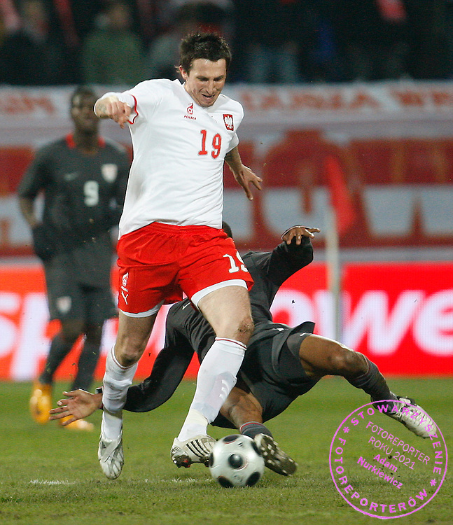 KRAKOW 26/03/2008.INTERNATIONAL FRIENDLY.POLAND v USA.MICHAL GOLINSKI OF POLAND IS TACKLED BY RICARDO CLARK OF USA.FOT. PIOTR HAWALEJ / WROFOTO