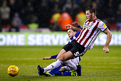 Adam Reach of Sheffield Wednesday tackles Jack O'Connell of Sheffield United - Mandatory by-line: Robbie Stephenson/JMP - 09/11/2018 - FOOTBALL - Bramall Lane - Sheffield, England - Sheffield United v Sheffield Wednesday - Sky Bet Championship