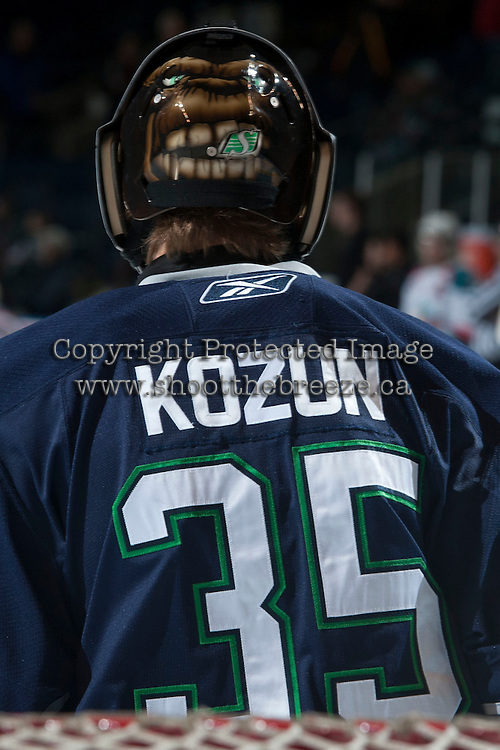 KELOWNA, CANADA -FEBRUARY 10: Taran Kozun #35 of the Seattle Thunderbirds stands in net against the Kelowna Rockets on February 10, 2014 at Prospera Place in Kelowna, British Columbia, Canada.   (Photo by Marissa Baecker/Getty Images)  *** Local Caption *** Taran Kozun