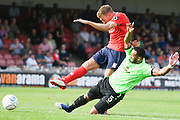 Simon Heslop of York City (8) shoots during the Vanarama National League North match between York City and Curzon Ashton at Bootham Crescent, York, England on 18 August 2018.