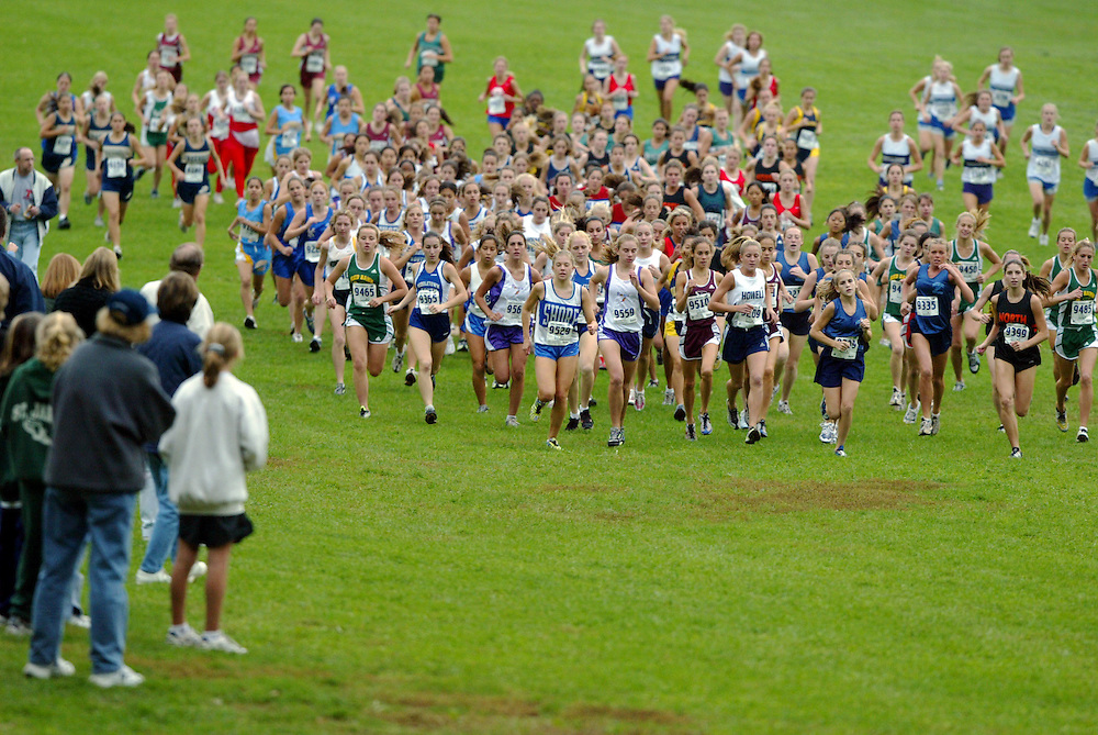 (SPORTS) Holmdel 10/15/2002  A sea of girls varsity racers run up hill into the woods of the Monmouth County Championships      Michael J. Treola Staff Photographer....MJT
