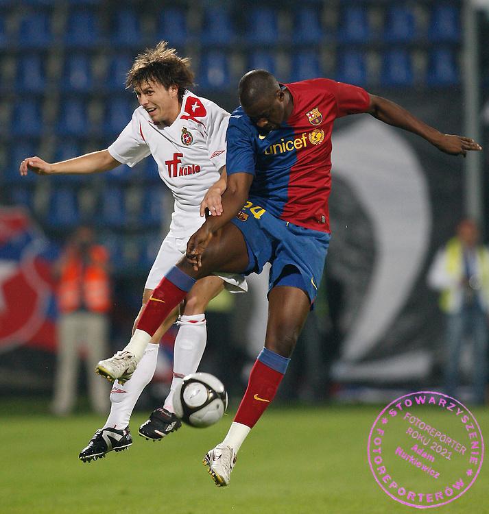 KRAKOW 26/08/2008.UEFA CHAMPIONS LEAGUE.THIRD QUALIFYING ROUND.SECOND LEG.WISLA KRAKOW v FC BARCELONA.NA ZDJ. RAFAL BOGUSKI /WISLA/ AND YAYA TOURE /BARCELONA/.FOT. PIOTR HAWALEJ / WROFOTO.