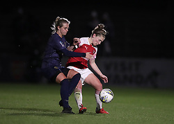 Arsenal Women's Kim Little (right) and Manchester United Women's Mollie Green (left) battle for the ball