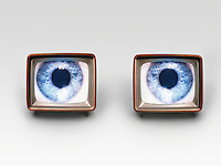 Two television sets with eyes on screens digital composite