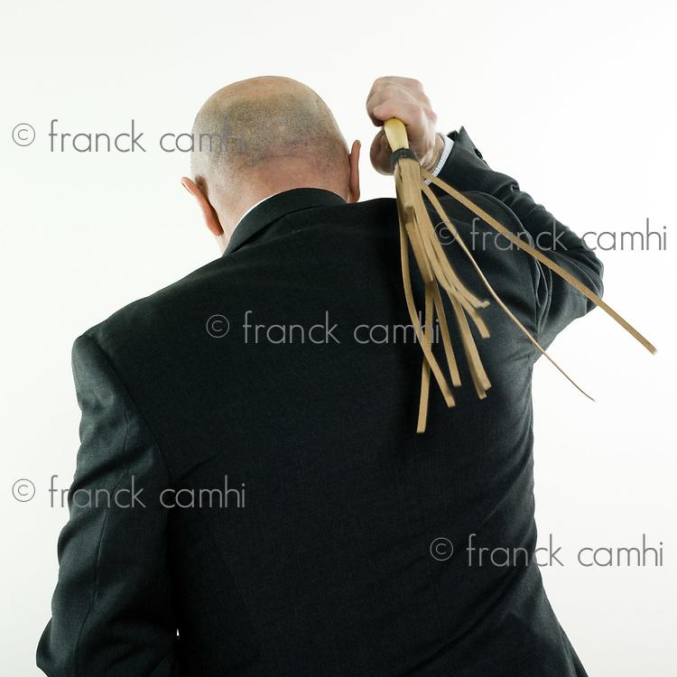 studio portrait isolated on white background of a man senior back whipping himself