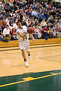 1/6/2006: Junior guard Luke Cooper (14) of the UAA Seawolves tosses a bullet pass into the lane as Anchorage goes on to beat the visiting Central Washington Wildcats, 80-60 at the Wells Fargo Sports Complex on the campus of UAA.<br />