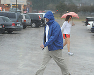 Voters go to the polls in the rain at the National Guard Armory in Oxford, Miss. on Tuesday, November 2, 2010.