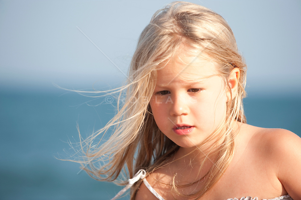 small girl with blonde hair outdoors