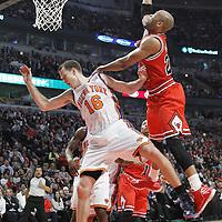 12 March 2012: Chicago Bulls forward Taj Gibson (22) goes for the layup over New York Knicks small forward Steve Novak (16) during the first half of New York Knicks vs Chicago Bulls, at the United Center, Chicago, Illinois, USA.