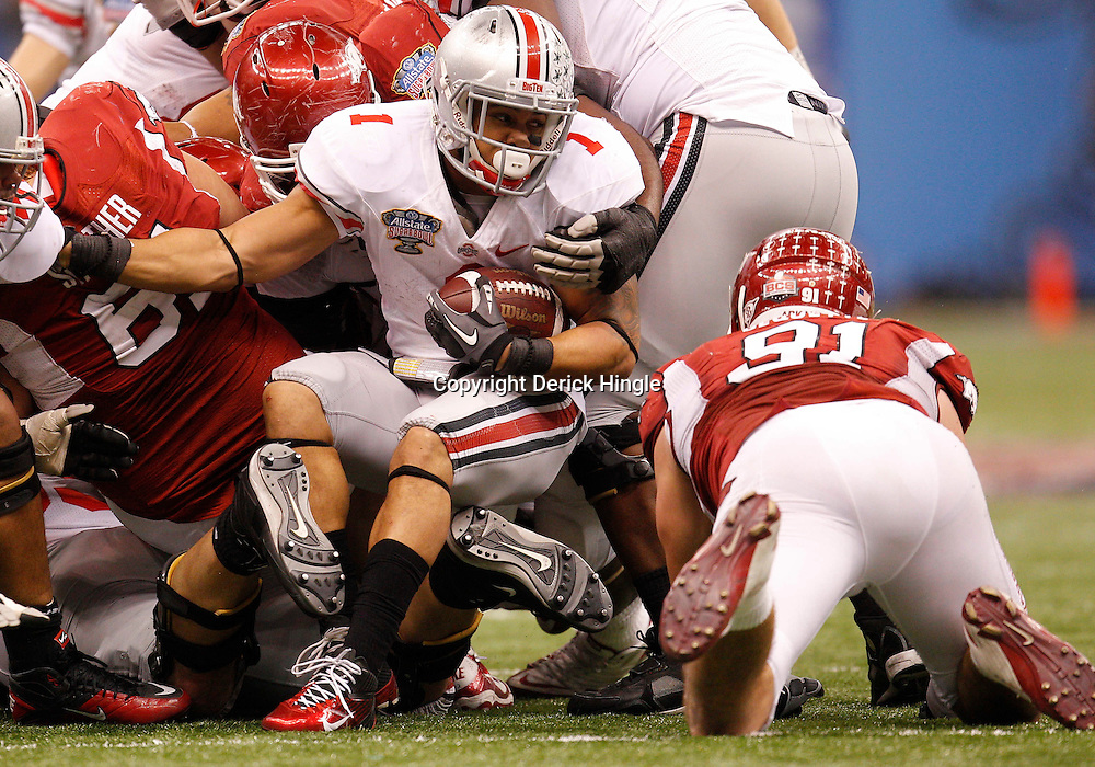 January 4, 2011; New Orleans, LA, USA; Ohio State Buckeyes running back Dan Herron (1) is stuffed at the line of scrimmage by the Arkansas Razorbacks defense during the fourth quarter of the 2011 Sugar Bowl at the Louisiana Superdome.Ohio State defeated Arkansas 31-26. Mandatory Credit: Derick E. Hingle