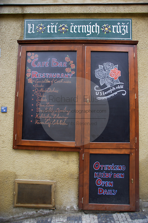 A cafe advertises their menu on decretive calkboards in Prague, Czech Republic.