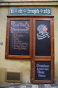 A cafe advertises their menu on decretive calkboards in Prague, Czech Republic.