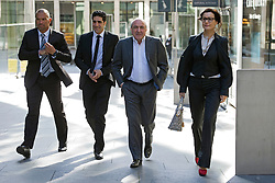 **CAPTION CORRECTION** © London News Pictures. 31/08/2012. London, UK. Russian Oligarch Boris Berezovsky (centre) arriving at The Royal Courts Of Justice with security (left) and his girlfriend Yelena Gorbunova (right) on August 31, 2012 where a judge has AGAINST BEREZOVSKY  in a  £3.2 billion lawsuit over Abramovich's £10.3 billion fortune. Photo credit: Ben Cawthra/LNP