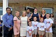 Massapequa, New York, USA. August 5, 2018. At Democrat campaign office opening, L-R, supporter; LAURA GILLEN, Hempstead Town Supervisor; LIUBA GRECHEN SHIRLEY, Congressional candidate for NY 2nd District; JOANNE CURRAN PERRUCCI, candidate for Court Judge 4th District; LAURA CURRAN, Nasssau County Executive, and Perrucci's four children, pose at opening of campaign office, aiming for a Democratic Blue Wave in November midterm elections.