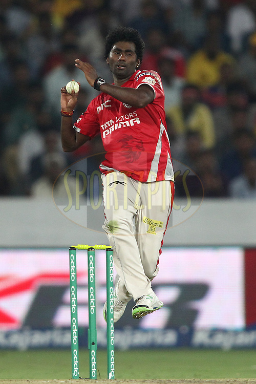 Parvinder Awana of the Kings XI Punjab sends down a delivery during the second semi final match of the Oppo Champions League Twenty20 between the Kings XI Punjab and the Chennai Superkings held at the Rajiv Gandhi Cricket Stadium, Hyderabad, India on the 2nd October 2014<br /> <br /> Photo by:  Shaun Roy / Sportzpics/ CLT20<br /> <br /> <br /> Image use is subject to the terms and conditions as laid out by the BCCI/ CLT20.  The terms and conditions can be downloaded here:<br /> <br /> http://sportzpics.photoshelter.com/gallery/CLT20-Image-Terms-and-Conditions-2014/G0000IfNJn535VPU/C0000QhhKadWcjYs