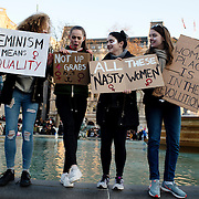 London UK. January 21st 2017.An estimated 100,000 protesters took part in a Women's March from the US Embassy in Grosvenor Square to Trafalgar Square as part of an international campaign on the first full day of Donald Trump's Presidency of the United States. A group of young women from South London pose with their placards in Trafalgar Square.