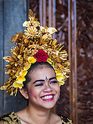 22 JULY 2016 - TENGANAN DUAH TUKAD, BALI, INDONESIA: A girl in her traditional costume and makeup in the Tenganan Duah Tukad village on Bali before the Pandanus fights. The ritual Pandanus fights are dedicated to Hindu Lord Indra. Men engage in ritual combat with spiky pandanus leaves and rattan shields. They usually end up leaving bloody scratches on the combatants' backs. The young girls from the community wear their best outfits to watch the fights. The fights have been traced to traditional Balinese beliefs from the 14th century CE. The fights are annual events in the Balinese year, which is 210 days long, or about every seven months in the Gregorian calendar.    PHOTO BY JACK KURTZ