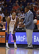 Apr 7, 2013; Phoenix, AZ, USA; Phoenix Suns head coach Lindsey Hunter talks with forward P.J. Tucker (17) in the second half of the game against the New Orleans Hornets at US Airways Center. The Hornets defeated the Suns 95-92. Mandatory Credit: Jennifer Stewart-USA TODAY Sports