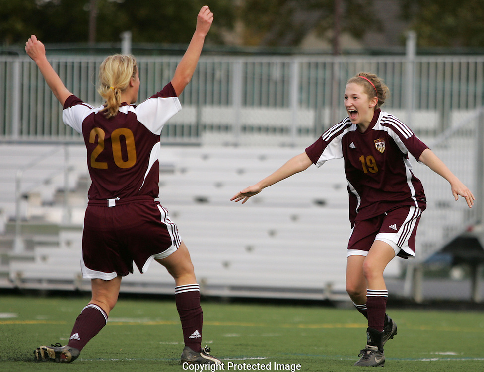 Watterson's Ellie Gavin (20) rushes to congratulate teammate Tyler Bucci (19) after Bucci scored the team's second goal against Dublin Jerome during the Division I Championship game Saturday October 25, 2008.