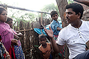 PVCHR activist Mangla Parsad, 34, is talking to villagers in Rajbhar village, around 20 kilometres from Varanasi, Uttar Pradesh, India.