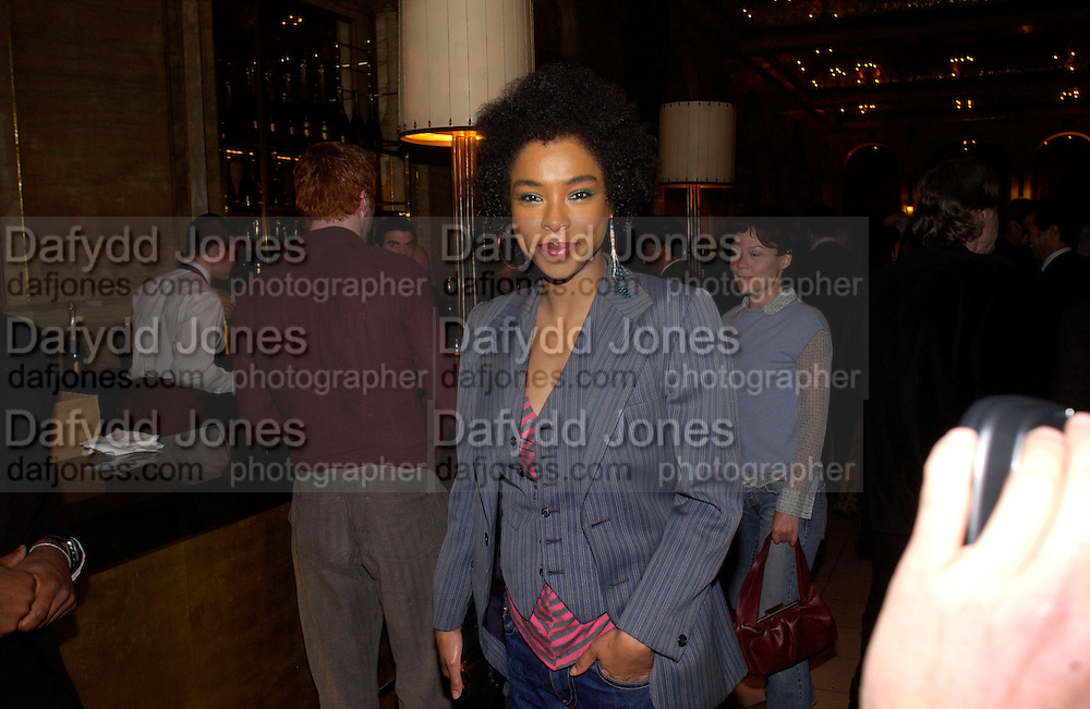 Sophie Okonedo, Krug Christmas party, hosted by Sir Trevor Nunn and Imogen Stubbs, the Criterion, 10 December 2003. © Copyright Photograph by Dafydd Jones 66 Stockwell Park Rd. London SW9 0DA Tel 020 7733 0108 www.dafjones.com