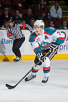 KELOWNA, CANADA - MARCH 23: Damon Severson #7 of the Kelowna Rockets skates with the puck against the Tri-City Americans on March 23, 2014 at Prospera Place in Kelowna, British Columbia, Canada.   (Photo by Marissa Baecker/Shoot the Breeze)  *** Local Caption *** Damon Severson;