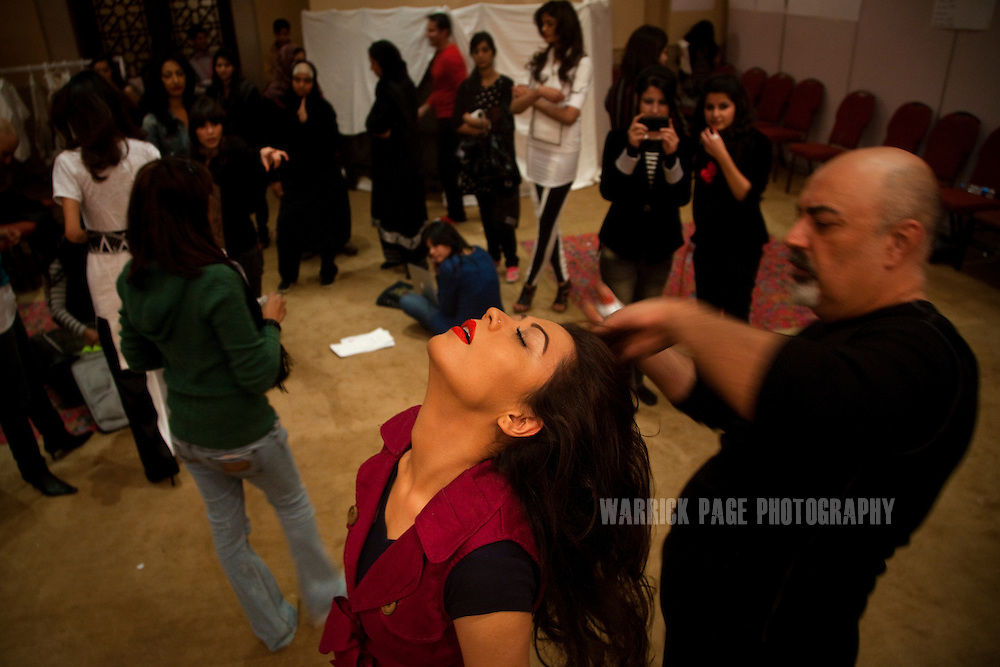A model has her hair done backstage by stylist, Tariq Amin (R), on the first day of the Islamabad Fashion Week, on 28 January, 2011, in Islamabad, Pakistan. Renowned Pakistani fashion designers showcase their wares over 4 days in the countries capital. Pakistan faces an ongoing social struggle between modernity and conservativeness with the country strongly divided over the role and influence of religion in society. (Photo by Warrick Page)
