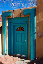 Blue door frame of adobe style building, Albuquerque, New Mexico, United States of America