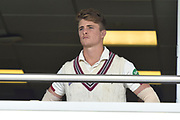 Somerset captain Tom Abell looks out from the team balcony during the rain delay during the Specsavers County Champ Div 1 match between Somerset County Cricket Club and Essex County Cricket Club at the Cooper Associates County Ground, Taunton, United Kingdom on 26 September 2019.