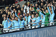 Vincent Kompany (4) of Manchester City lifts the Carabao Cup  with his team mates in the royal Box after a 3-0 win over Arsenal during the EFL Cup Final match between Arsenal and Manchester City at Wembley Stadium, London, England on 25 February 2018. Picture by Graham Hunt.