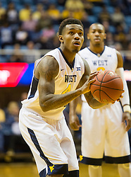 Dec 5, 2015; Morgantown, WV, USA; West Virginia Mountaineers guard Daxter Miles Jr. (4) shoots a foul shot during the second half against the Kennesaw State Owls at WVU Coliseum. Mandatory Credit: Ben Queen-USA TODAY Sports