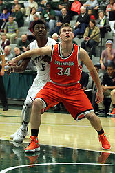 17 November 2015:  Jaylen Beasley(5) gets blocked out by Ethan Leib during an NCAA men's division 3 CCIW basketball game between the Greenville College Panthers and the Illinois Wesleyan Titans in Shirk Center, Bloomington IL