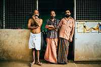 Neriamangalam, India -- February 17, 2018: Three gentlemen owners of a small toddy shop--which serves homemade coconut and palm wines, as well as local Keralan dishes--near the Periyar river in Kerala, India.