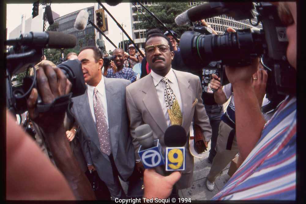 The OJ Simpson trial and media circus.<br /> OJ Simpson's lawyers Johnny Cochran and Robert Shapiro outside the Criminal Courts Building.