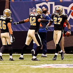 December 12, 2010; New Orleans, LA, USA; New Orleans Saints cornerback Malcolm Jenkins (27) celebrates with teammates Darren Sharper (42) and Lance Moore (16) during the first half against the St. Louis Rams at the Louisiana Superdome. Mandatory Credit: Derick E. Hingle-US PRESSWIRE
